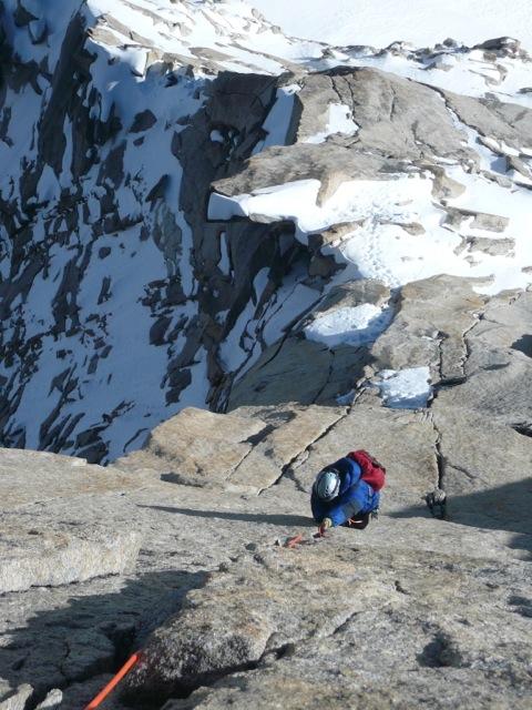 A Person Climbing Up the Mountain