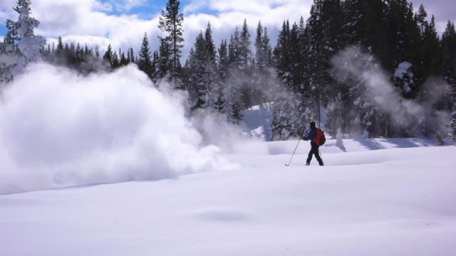 A Man Walking Through a Snowy Area