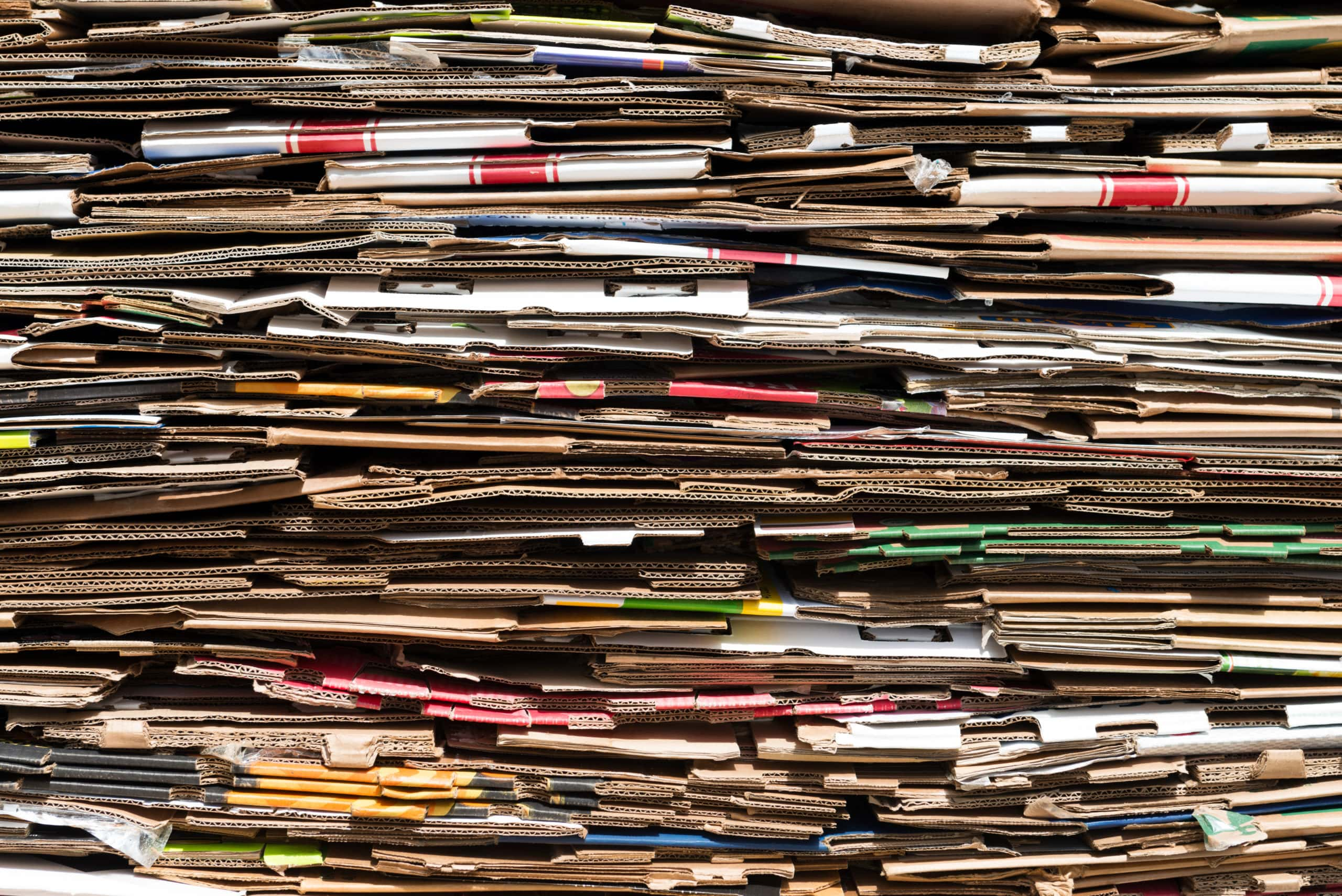 Pile of old cardboard boxes forming background