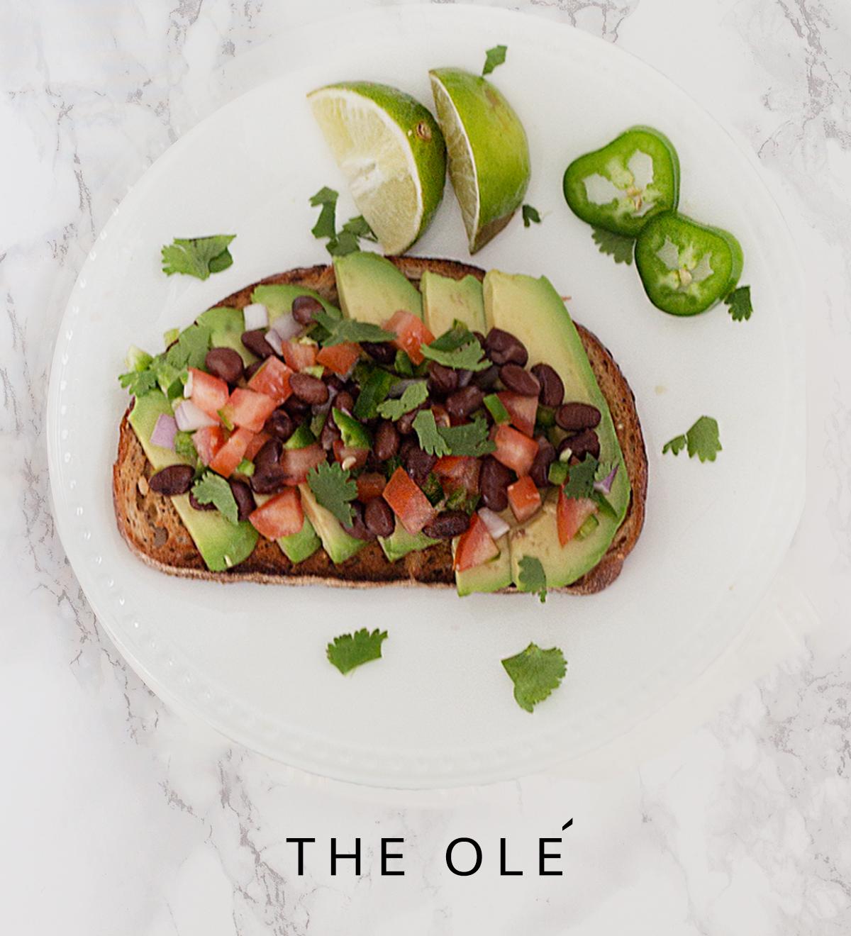 avocado toast with black bean pico de gallo and lime