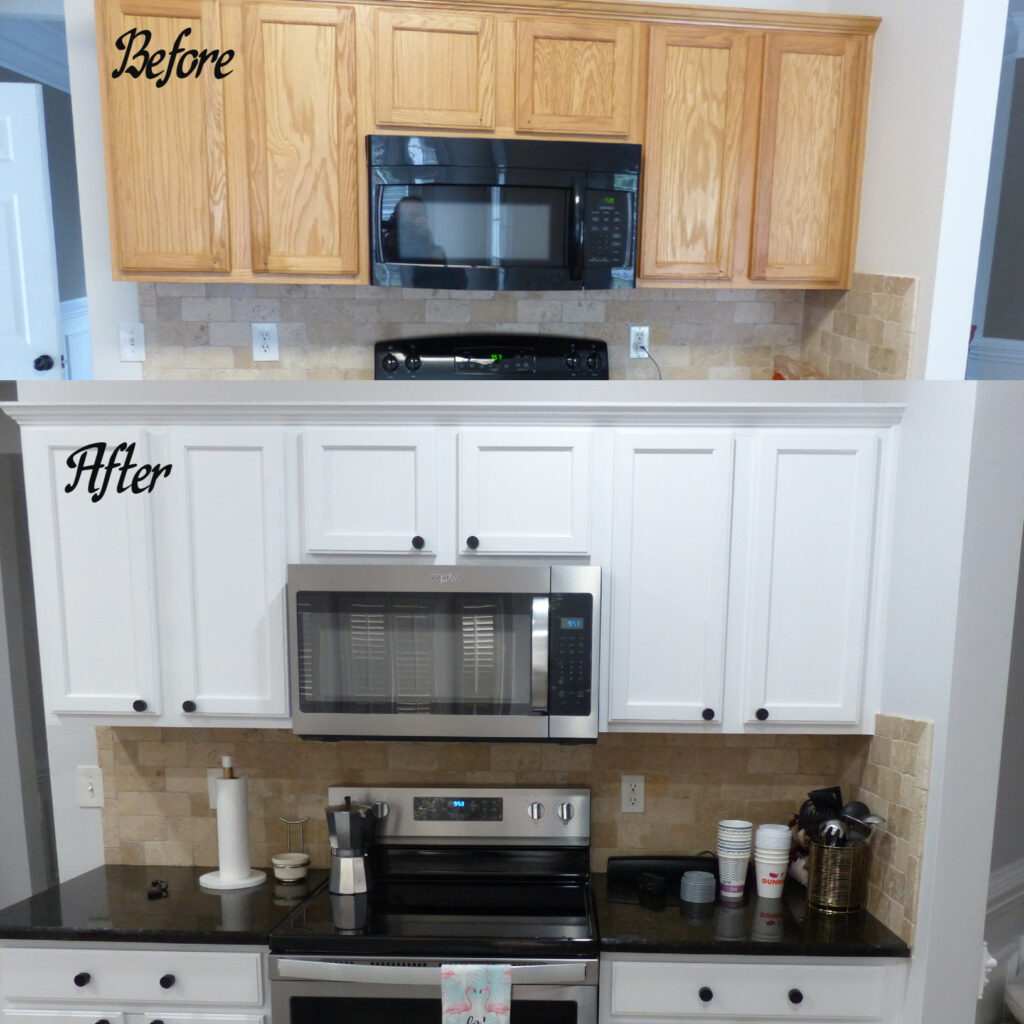 Homeowner opted to refinish their kitchen in an extra white semi-gloss, upgrading appliances to stainless steel, and changed out to black knobs