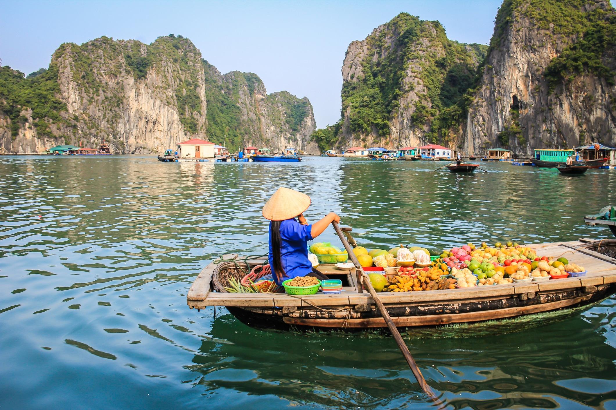 Fruit seller in a boat , Halong Bay Vietnam