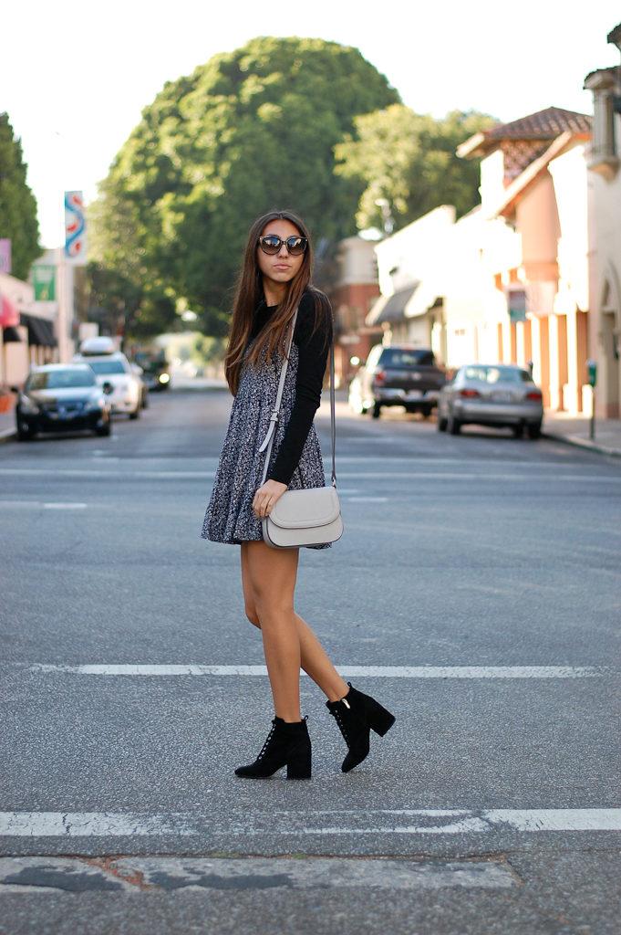 black shirt black floral dress looking