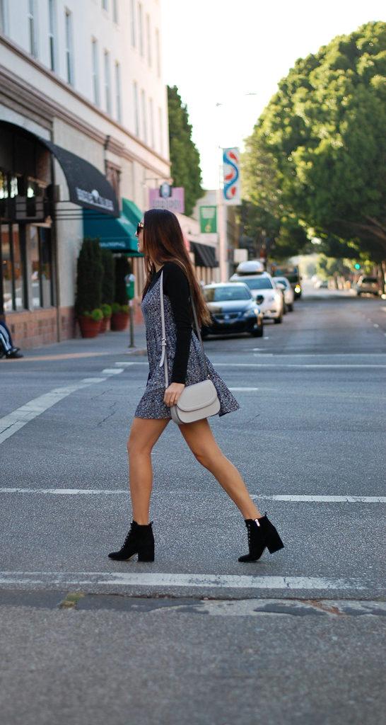 black shirt black floral dress walking