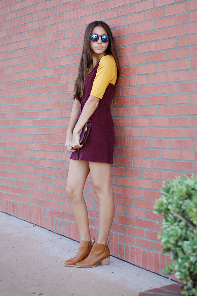 corduroy dress yellow top leaning
