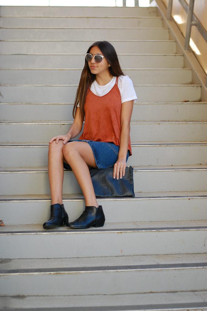 red tank white shirt skirt sitting