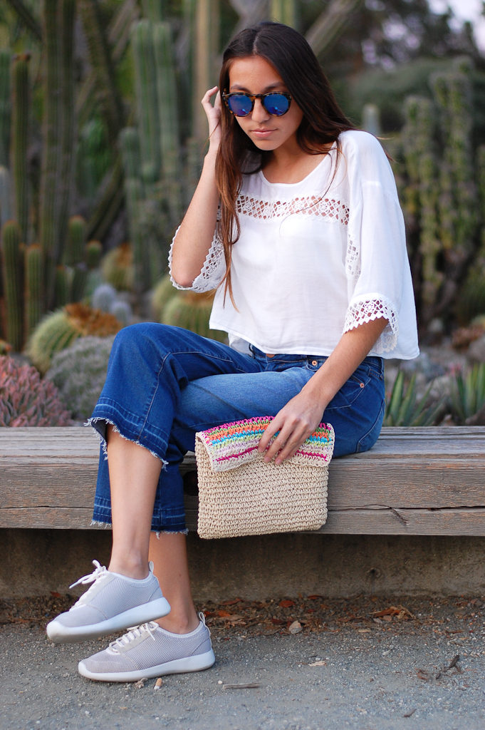White crop top cropped jeans sitting