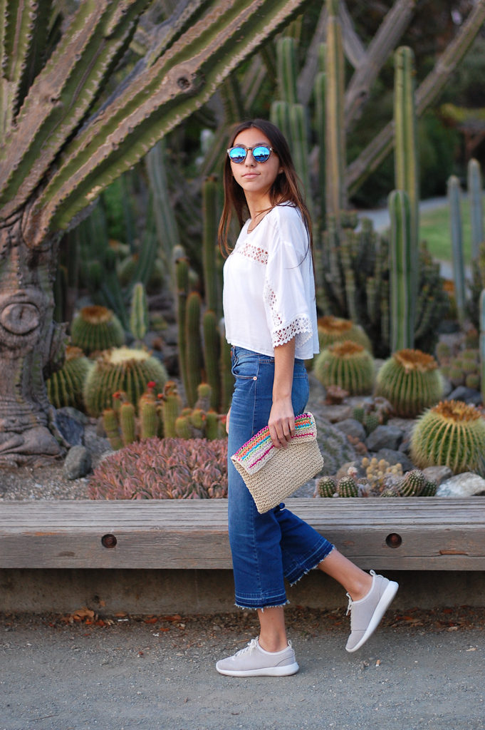 White crop top cropped jeans walking