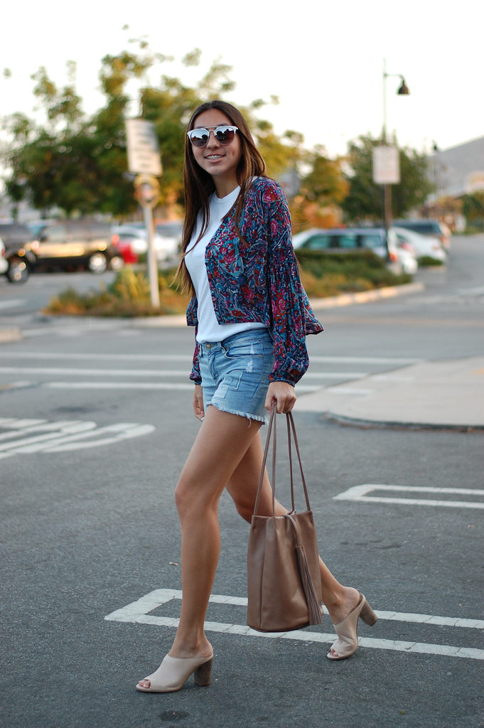 White shirt patch shorts walking
