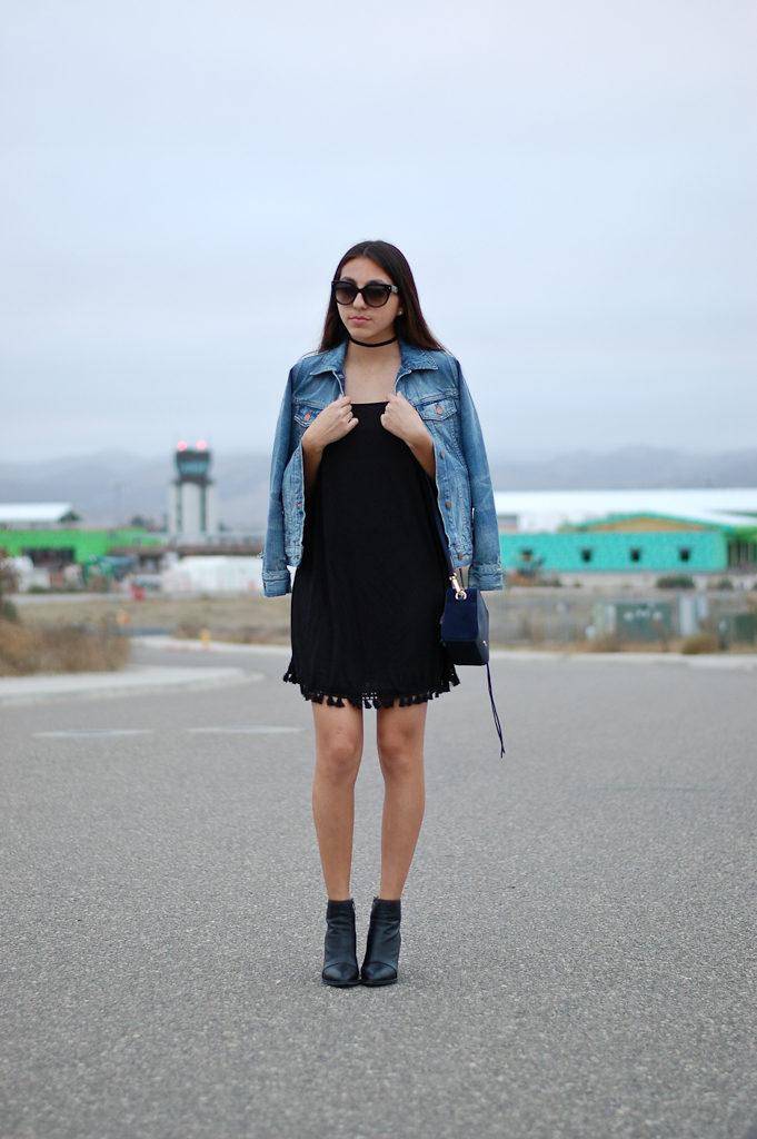 black dress denim jacket holding