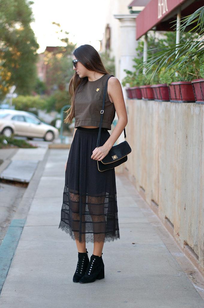 green top black skirt