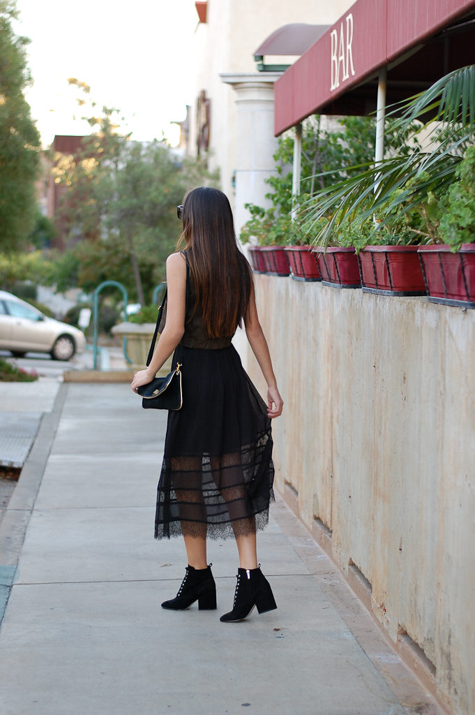 green top black skirt back