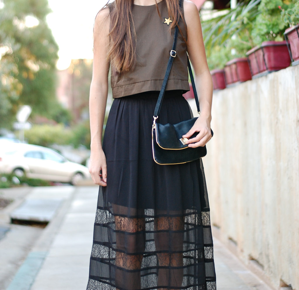green top black skirt middle