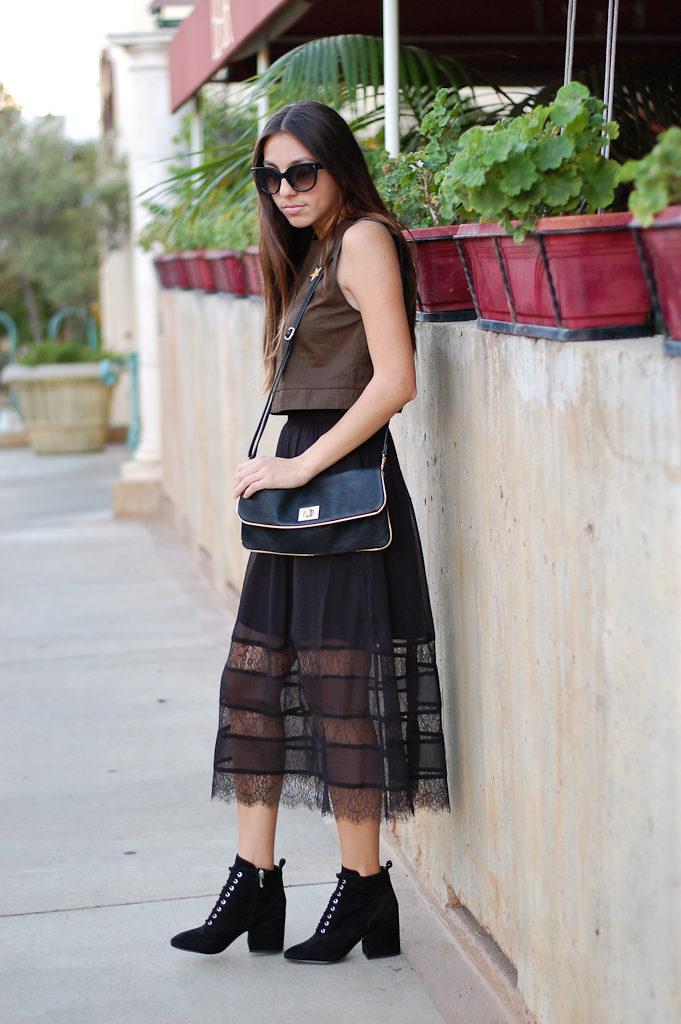 green top black skirt side