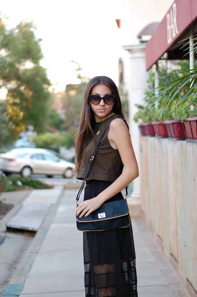 green top black skirt side top