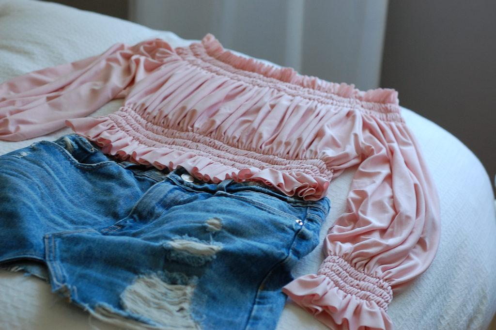 Pink off the shoulder top Denim skirt Flatlay
