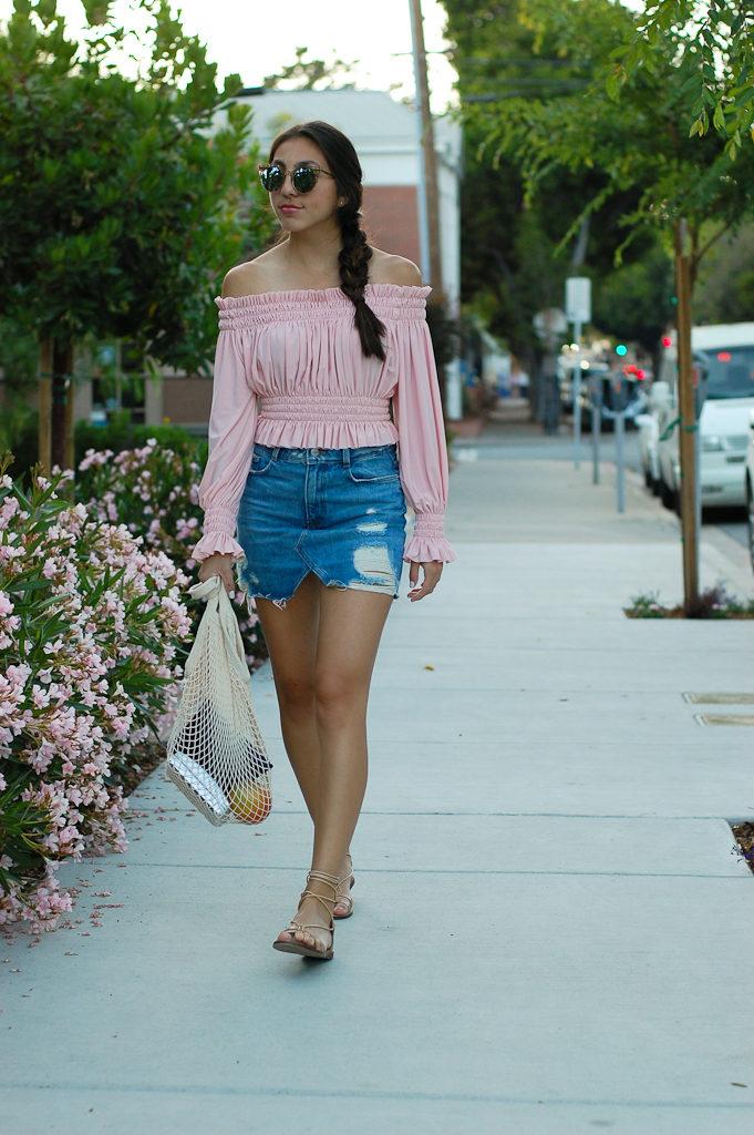 Pink off the shoulder top Denim skirt walking full