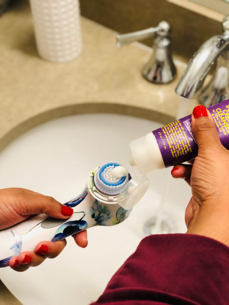 add a dime sized amount of cleanser to your facial brush.
