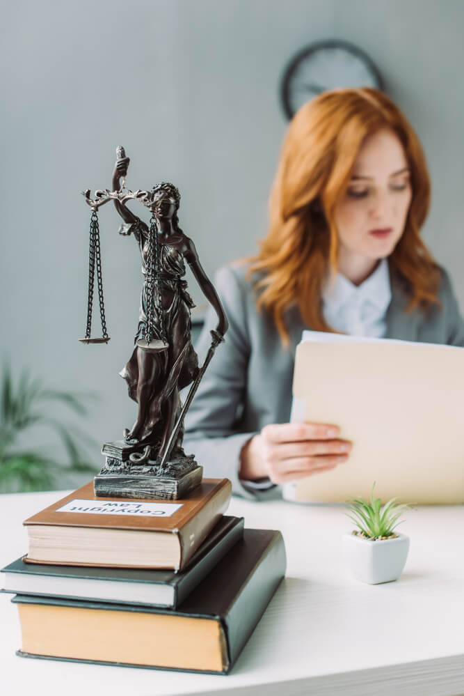 female lawyer looking at files