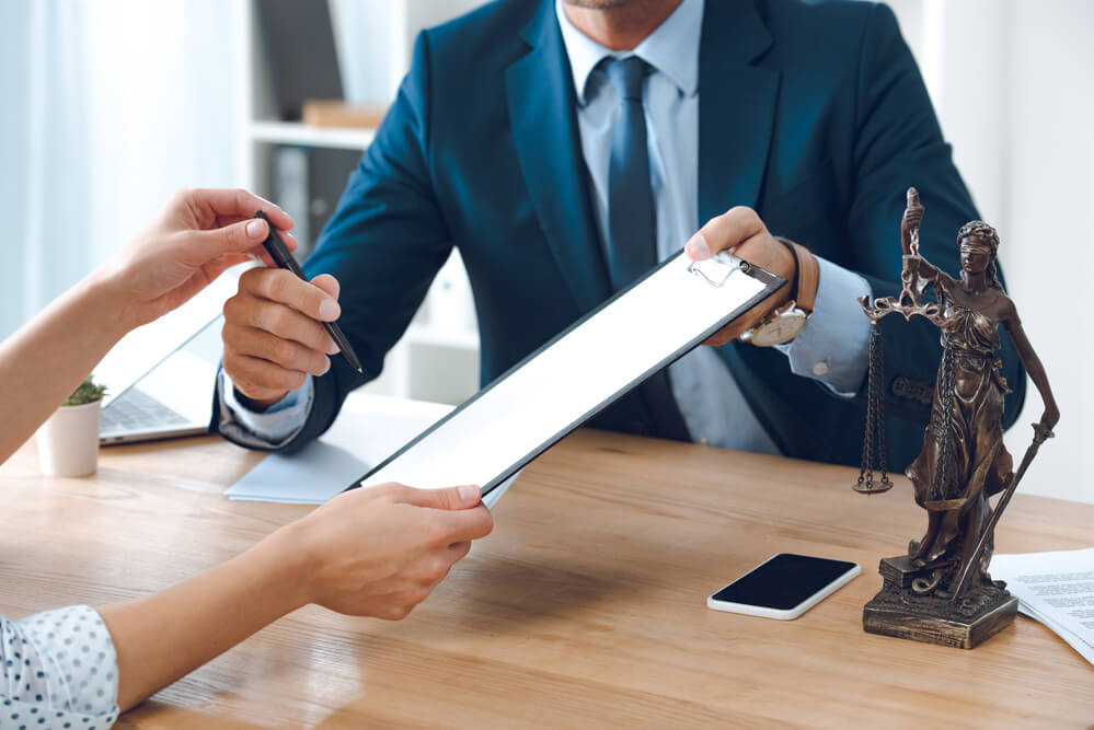 lawyer working with client