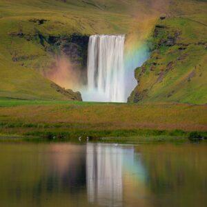 Rainbow reflection at Skogafoss Iceland