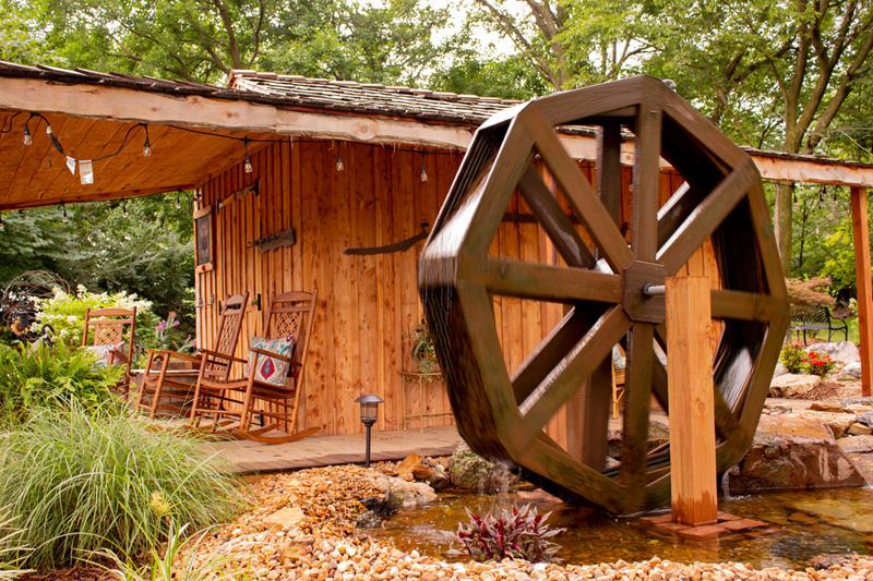 Peaceful nature waterwheel next to cedar cabin