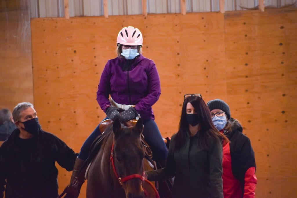 tbtra inside barn with rider