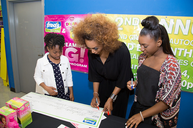 Madison Evans receiving her scholarship award from  Cynthia Bailey & Noelle Robinson