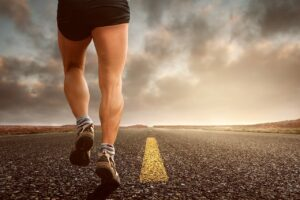 Be an Elite Athlete - man running down a highway.