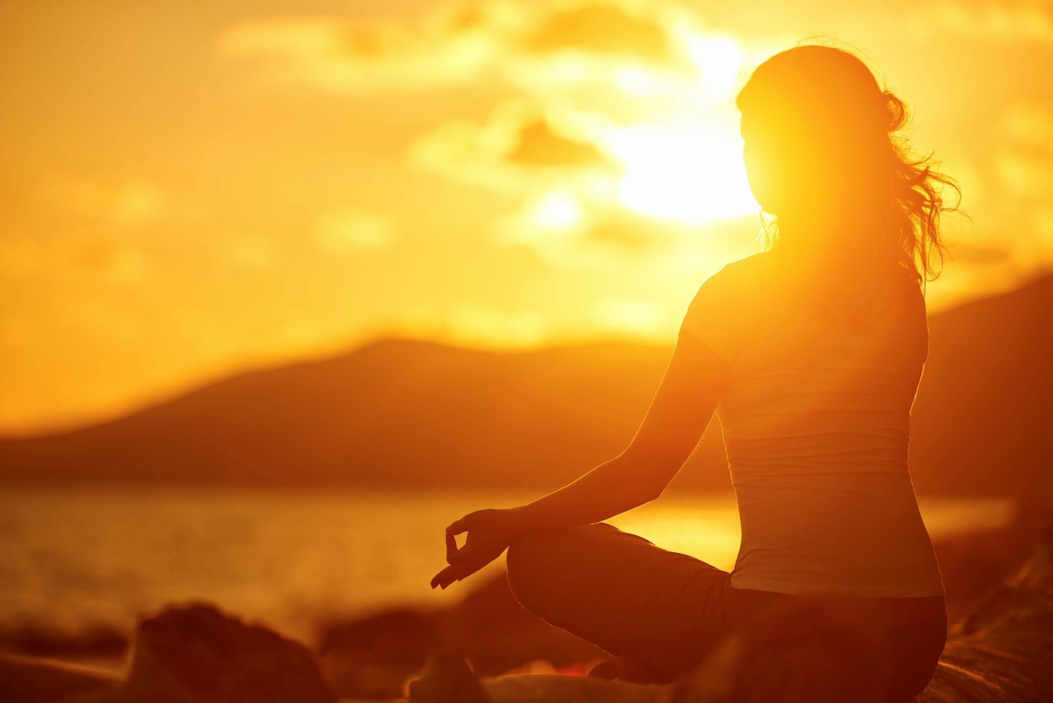 Recharge with yoga zen at sunset.