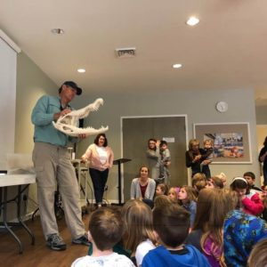 Tony Mills shows students what an alligator skull can do at a weekly wow workshop in the Learn Together Lowcountry homeschool co-op in Bluffton SC