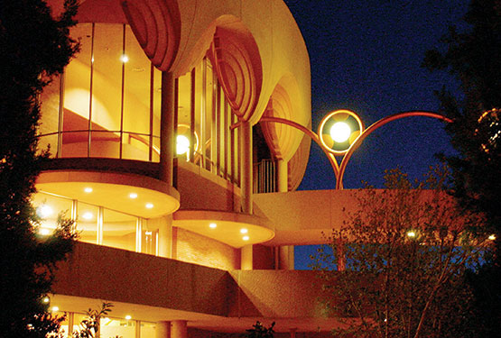 Frank Lloyd Wright's architecture for ASU Gammage Auditorium is seen at its best when illuminated for an evening performance.