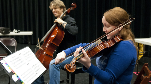 """Kate Haas and David Dickinson learn to believably bow instruments for the Actors Theatre production of """"Opus."""" (Photo by Molly J. Smith, Arizona Republic)"""