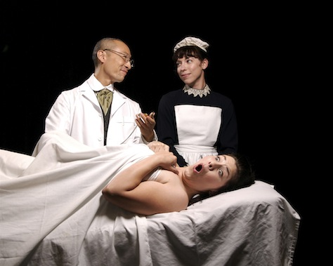 """Sarah Ruhl's historical comedy """"In the Next Room (or the Vibrator Play)"""" stars Erica Connell (on table), Francis Jue and Lauren Dykes. (Photo by John Groseclose)"""
