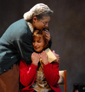 Cathy (right) is a mom being consoled by her adoptive other (Maria Amorocho) in Arizona Jewish Theatre's multigenerational drama, Kindertransport, produced in 2008. (Photo credit unknown)