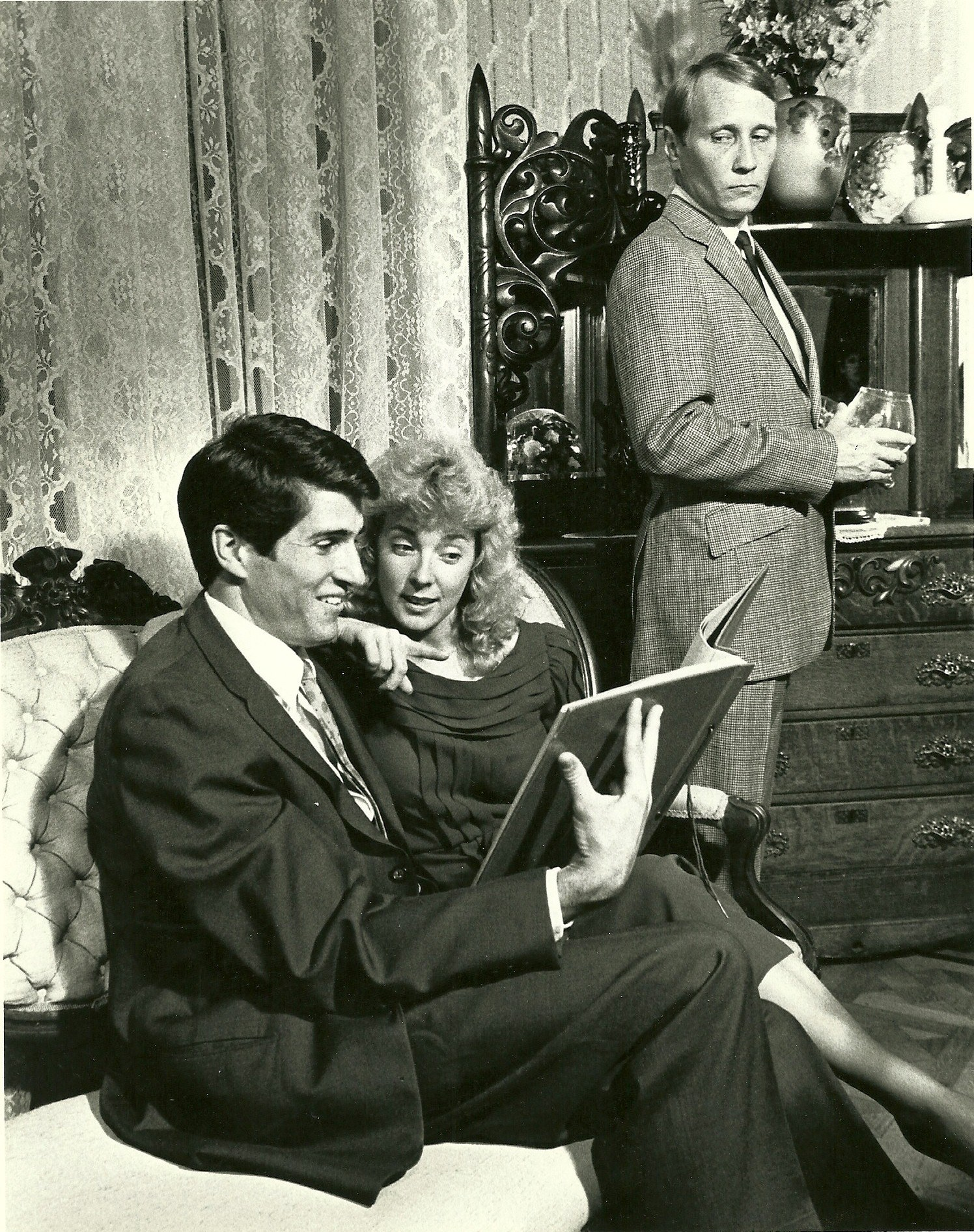 """Dial M for Murder, directed by Randal K. West and produced by Chris Curcio at 3rd Street Theatre April 14-27, 1985, featured David Helmstetter (left), Cathy Dresbach and Chris Witt in the cast. (Memorabilia courtesy of David Helmstetter) (The photo was staged at the historic Rosson House in downtown Phoenix.)"