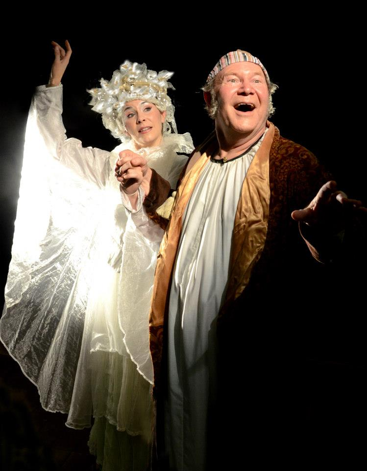 """Erica Connell is the Ghost of Christmas Past and David Vining is Scrooge in """"A Christmas Carol"""" at Southwest Shakespeare Company. (Photograph courtesy of the company.)"""