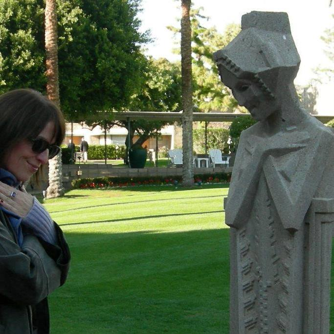 Katie strikes a pose with a Frank Lloyd Wright statue at the Arizona Biltmore Resort.