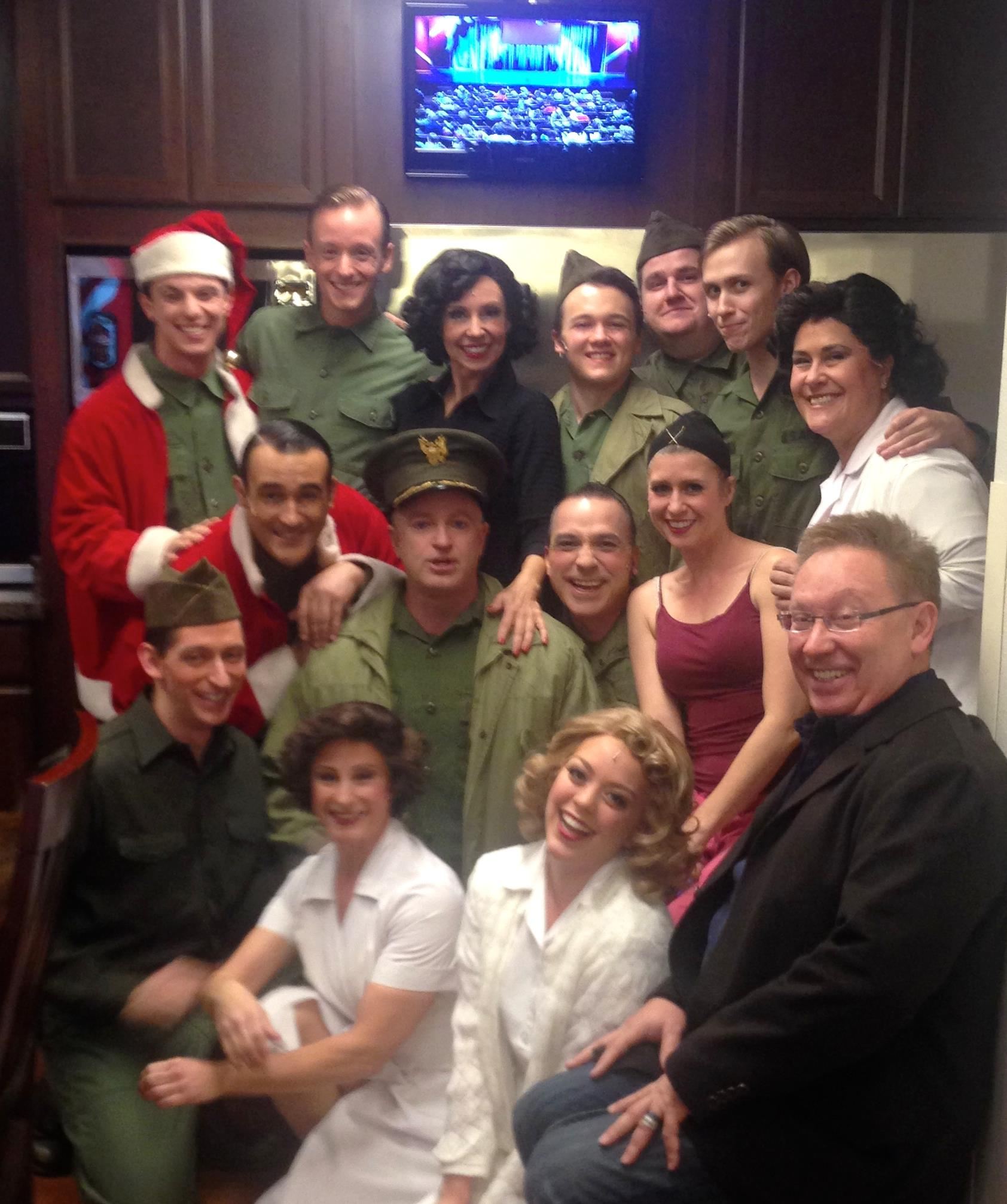 """Backstage at Phoenix Theatre's """"White Christmas."""" Included in the photo are with Peter Marinaro, Jonathan Brian, Joseph Cannon, Darcy Rould- Welch, Sam Hay, Chris Eriksen, Lauren Devine, Terry Gadaire, Kenny Francoeur, Pete Good, Molly Lajoie Plutnicki, Logan Scott Mitchell, Johanna Carlisle and Michael Barnard. (Photo credit unknown)"""