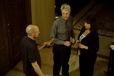 """Randy listens to the director during a break in filming the 2011 sci-fi indie, """"Intersect."""""""