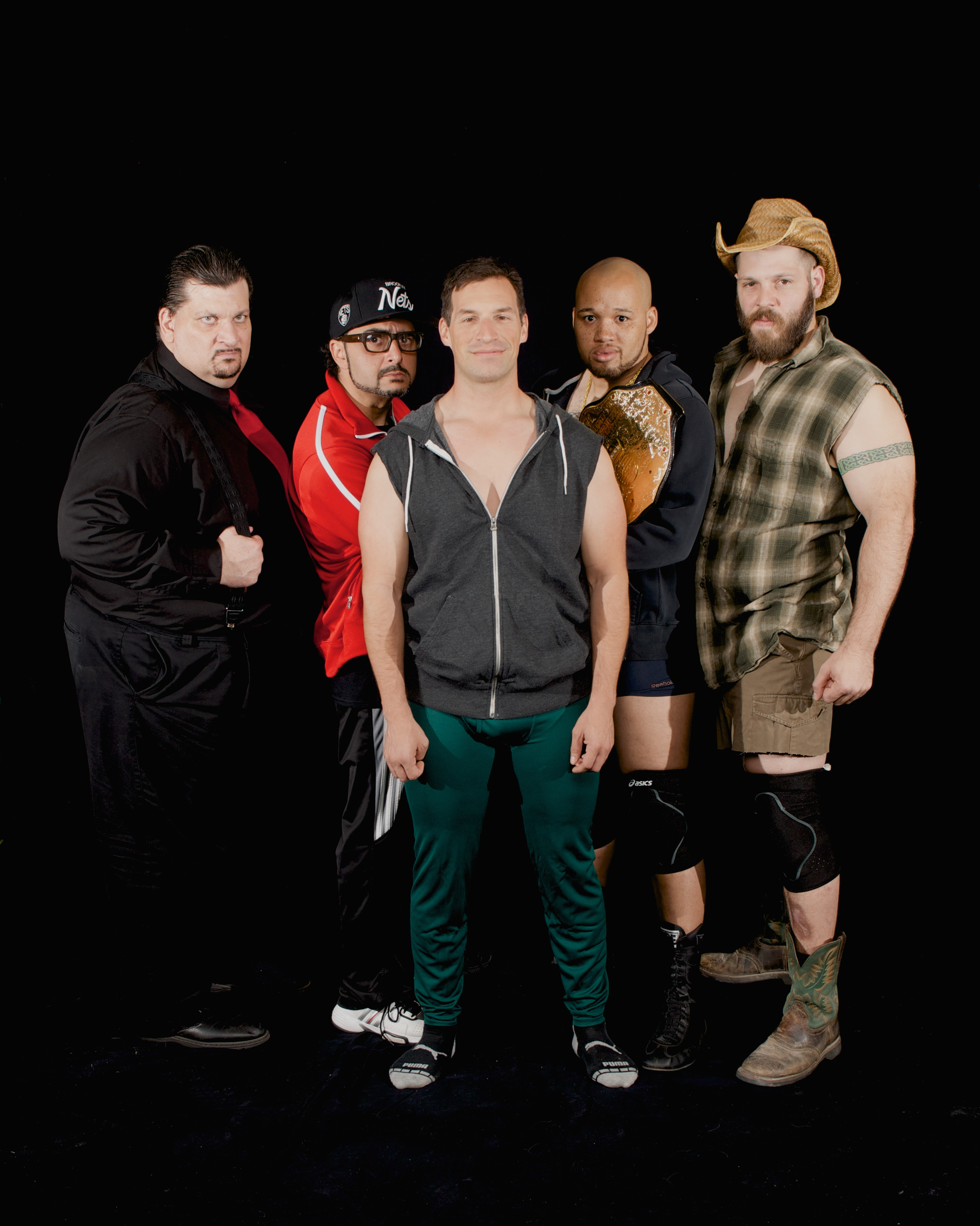 "Stray Cat Theatre, ""The Elaborate Entrance of Chad Deity,"" April 2014. Pictured: (l to r) Charles Campbell as EKO, Pasha Yamotahari as VP, Cisco Saavedra as Mace, Jeremy Gillett as Chad Deity and Keath David Hall as The Bad Guy. Photo by John Groseclose."