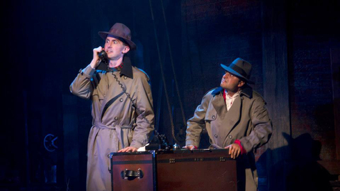 """Toby Yatso and Pasha Yamotahari in """"The 39 Steps,"""" Phoenix Theatre's 2013 send-up of the Alfred Hitchcock movie. (Photo by Sara Chambers.)"""