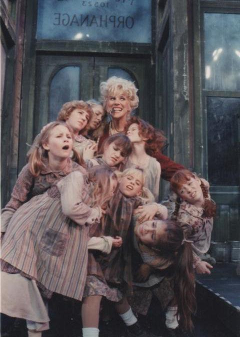 "Karen Morrow and the orphans in Musical Theatre Arizona's production of ""Annie"" in 1989. (Photograph courtesy of Andi Watson)"