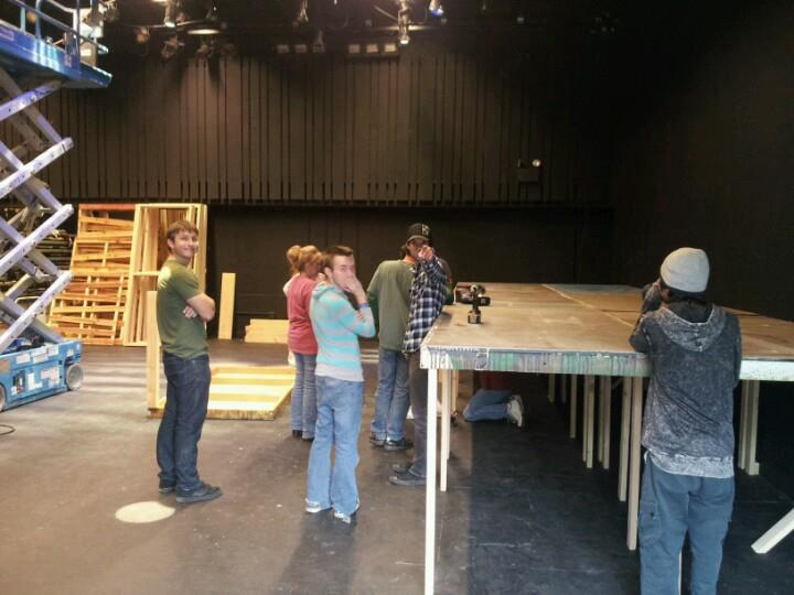 David Weiss may be the technical director at Nearly Naked Theatre, but the title doesn't keep him from getting down to the nitty gritty of building sets. That's his legs you see under the platform. (Photo from the David Weiss Collection)