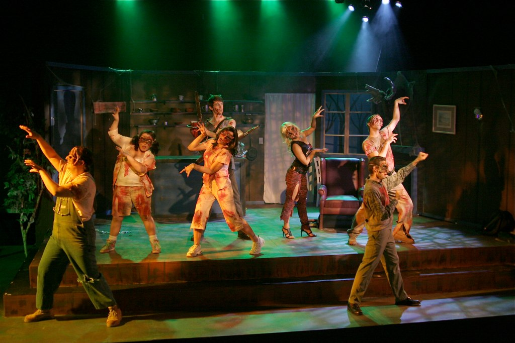 """Doing the zombie mash - Toby Yatso and the cast of """"Evil Dead: The Musical"""" at Nearly Naked Theatre Company. (Photo by lighting designer Jeff A. Davis)"""