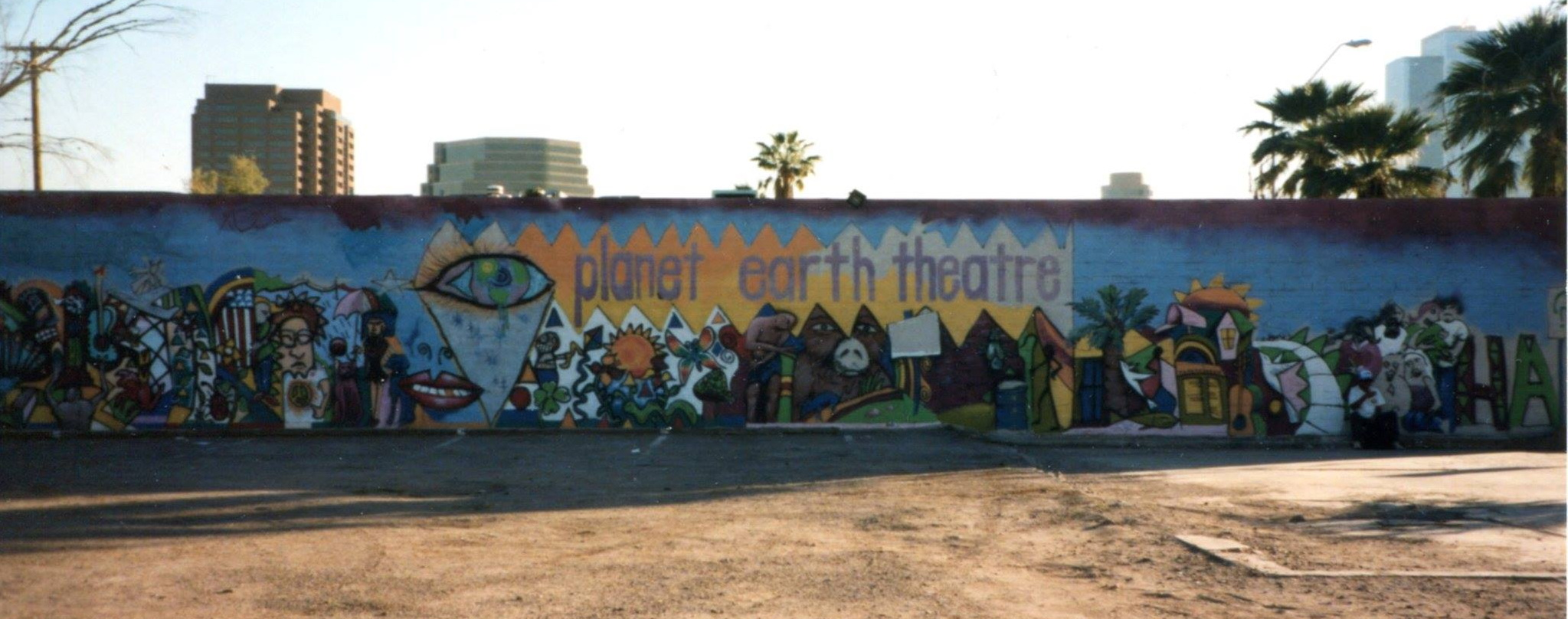 Planet Earth was as well-known for the mural that graced its exterior as it was for the plays it produced. Robert Anderson painted the artwork after being given an exhibition in the theater's art gallery. (Photo from the collection of Mollie Kellogg)