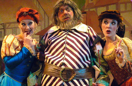 """Andi Watson, Gene Ganssle and Maren Maclean in """"The Merry Wives of Windsor,"""" Southwest Shakespeare Company, 2002. (Photograph by Laura Durant.)"""