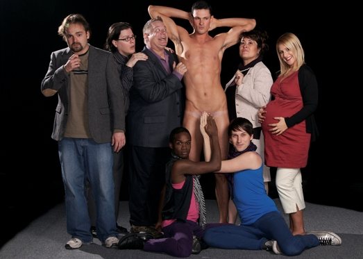 "The ensemble of ""The Play About the Naked Guy"": standing (left to right), Louis Farber, Matthew R. Harris, Doug Loynd, Marc Rambeau, Johanna Carlisle, and Emily Rubin; seated (left to right), Michael Thompson and Samuel E. Wilke (Photo by John Groseclose)"