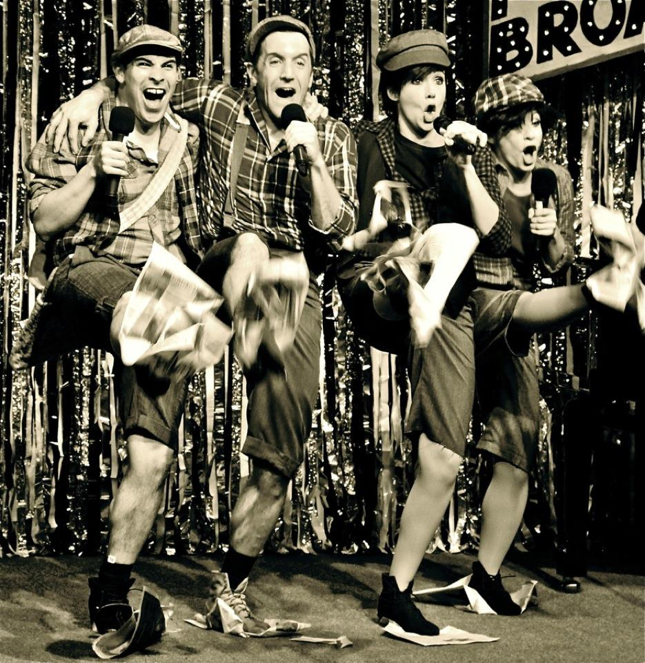 "Natalie Charle Ellis (3rd from left) performs a spoof of ""Newsies"" in ""Forbidden Broadway."" (Photo Credit Unknown)"