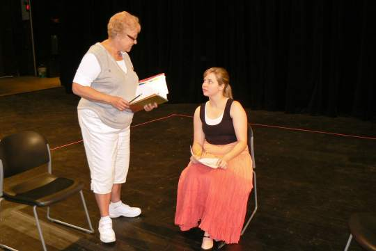 """Pam Fields, at left, founder of Scottsdale Conservatory Theatre's production of """"The Good Doctor,"""" rehearses a scene with participant Sarah Zorman. (Photo by Brett Nachman)"""